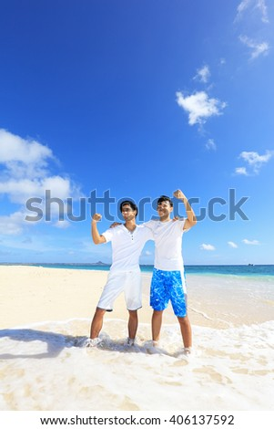 Happy young men on a tropical beach  #406137592