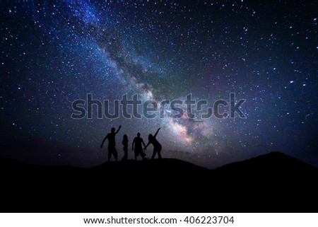 Peoples admiring the center of milky way in a night full of stars #406223704