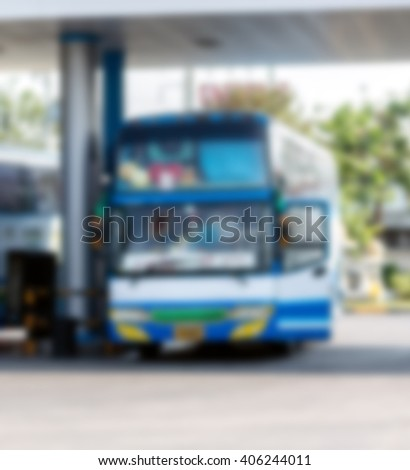Blurred gas station with bus #406244011