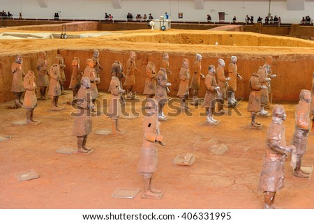 XIAN, CHINA - MAR 29, 2016: Terracotta Army (Soldier and horse funerary statues),  sculptures depicting the armies of Qin Shi Huang, the first Emperor of China. UNESCO World Heritage #406331995