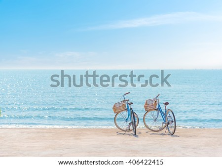 Two bicycle at the beach on blue sky #406422415