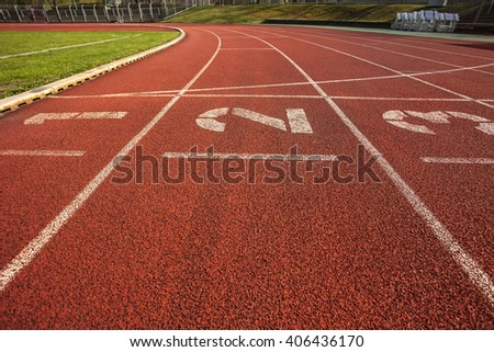 Running track in stadium with lane numbers #406436170