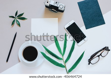 Creative flat lay photo of workspace desk with smartphone, coffee, film camera, blank paper and envelope with copy space background, minimal style #406464724