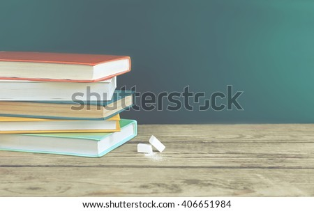 Few books with chalk on table #406651984