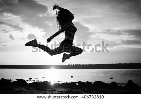 Black and white photography of dance and jump, silhouette outdoors background. Dawn sky