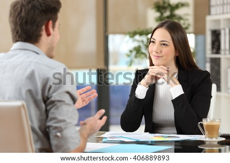 Businesswoman attending listening to a client who is talking at office Royalty-Free Stock Photo #406889893