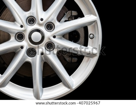 Silver modern car wheel on the black background #407025967