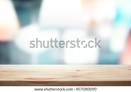 Empty of wood table top on light abstract background .For montage product display or design key visual layout #407080090
