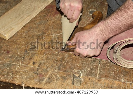 Carpenter working. Carpenter tools on wooden table with sawdust. Carpenter workplace #407129959