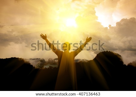 The man thank God on the mountain. Royalty-Free Stock Photo #407136463