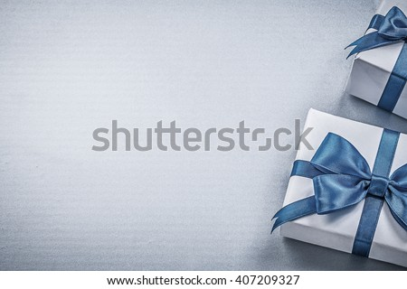 Present boxes on blue background greeting card holidays concept. #407209327