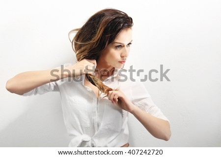 Strong hair.Portrait of a woman with beautiful long hair on a white background #407242720