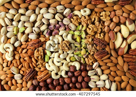 Natural background made from different kinds of nuts. Royalty-Free Stock Photo #407297545