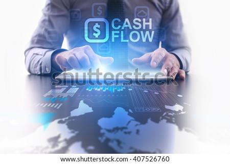 Businessman using tablet pc and select Cash flow. #407526760
