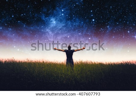 Silhouette of man and stars sky. Elements of this image furnished by NASA #407607793