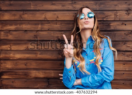 Cool hipster student woman wearing eyewear glasses . Caucasian female university student looking at camera smiling happy. Royalty-Free Stock Photo #407632294