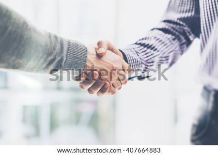 Business partnership meeting concept. Image businessmans handshake. Successful businessmen handshaking after good deal. Horizontal, blurred background Royalty-Free Stock Photo #407664883