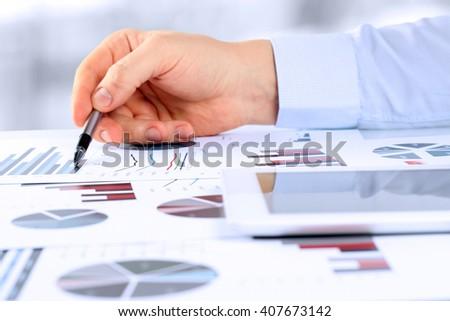 Close-up Of Businessman Analyzing Graphs #407673142