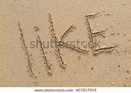 "written words ""like"" on sand of beach #407837854"