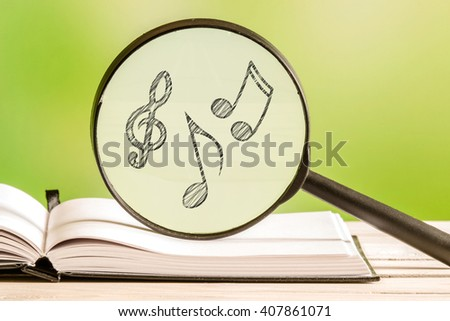 Music search with notes in a magnifying glass