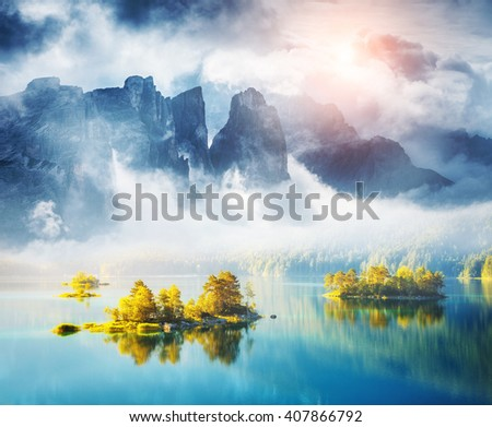 View of the islands and turquoise water at Eibsee Lake. Dramatic and picturesque scene. Location place Garmisch-Partenkirchen, Bavarian alp, Europe. Artistic picture. Creative collage. Beauty world.