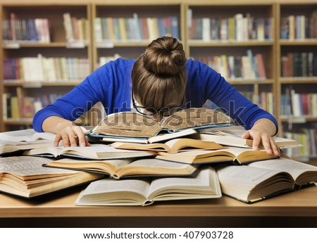 Student Studying Hard Exam and Sleeping on Books, Tired Girl Read Difficult Book in Library Royalty-Free Stock Photo #407903728