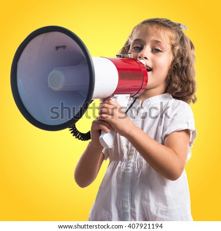Girl shouting by megaphone #407921194