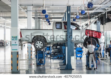 PHUKET, THAILAND - APRIL 19 : Car technician repairing car in workshop service station in Phuket on March 19, 2016. The official dealer of Toyota, who is the top market share for commercial car. #407925055