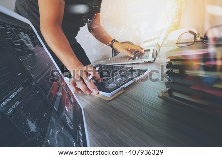 Website designer working digital tablet and computer laptop with smart phone and graphics design diagram and stack of books, work from home as concept #407936329