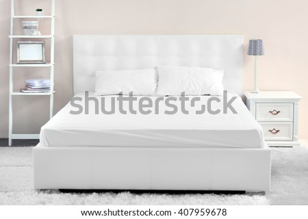 Comfortable white bed in the room #407959678