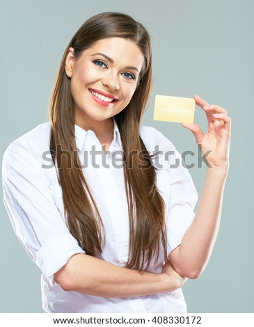 Smiling business woman show credit card. Isolated portrait.