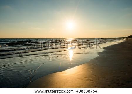 beautiful golden sunset on the beach #408338764