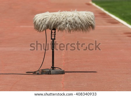 Furry sport microphone on a soccer field
