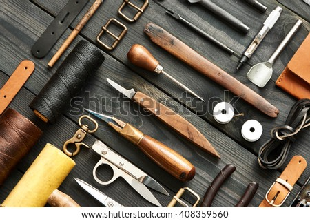 Leather crafting DIY tools flat lay still life  Royalty-Free Stock Photo #408359560