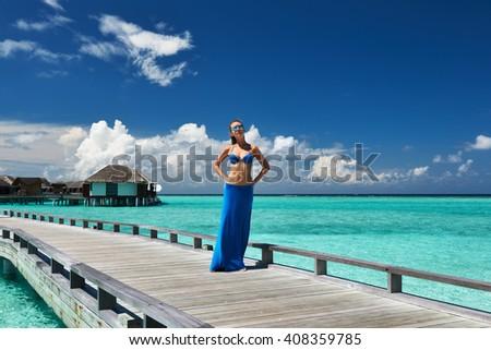 Woman on a tropical beach jetty at Maldives #408359785