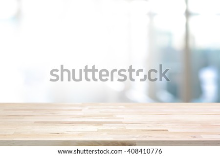 Wood table top on white blurred abstract background - can be used for display or montage your products #408410776