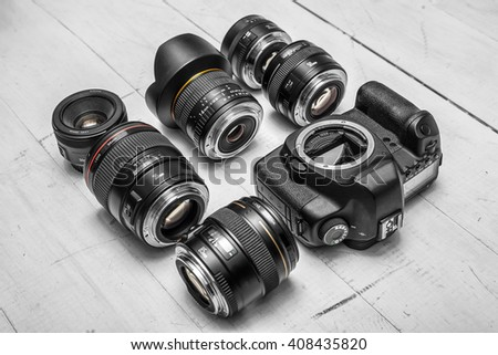 camera lenses laying on white wooden background  #408435820