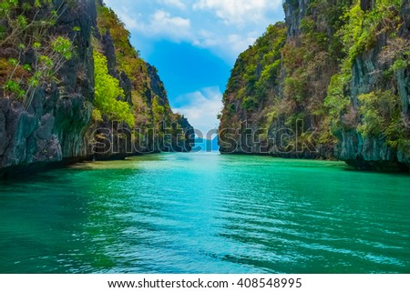Beautiful tropical landscape with blue lagoon and mountain islands, El Nido, Palawan, Philippines #408548995
