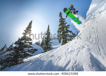 Flying snowboarder in the mountains #408621088