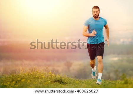 Athletic young man running in the nature. Healthy lifestyle #408626029