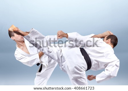 Kick leg in the performance of an athlete with black belt  a collage #408661723