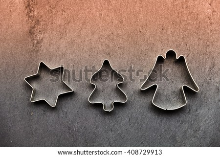 cookie cutter on colorful slate #408729913