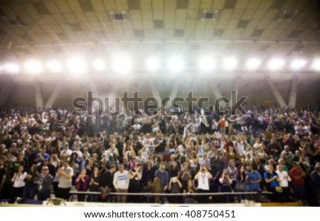 Blurred background of crowd of people in a basketball court Royalty-Free Stock Photo #408750451