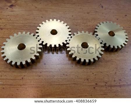 bronze gears on wood #408836659