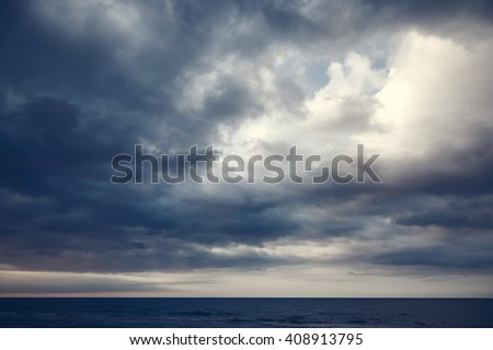 Dramatic dark cloudy sky over sea, natural photo background #408913795