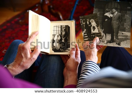 elderly couple reminding the past/ memories/ elderly couple reminding their wedding day