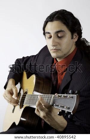 man playing a guitar #40895542