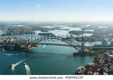 Aerial photo of Sydney CBD, The Rocks, Parramatta, North Sydney and Harbour bridge. Sydney iconic Harbour Bridge and suburbs. Bird's eye view from above on Sydney Harbour Royalty-Free Stock Photo #408986239