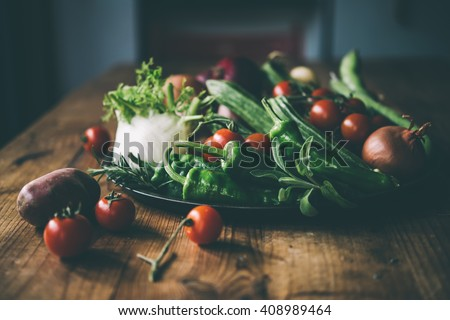 Different fresh farm vegetables on wooden table. Autumn harvest and healthy organic food concept. Toned picture