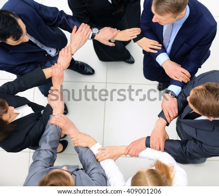 Top view of business people with their hands together in a circle #409001206
